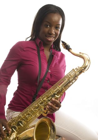 young pretty latin hispanic woman playing a tenor saxophone musical instrument
