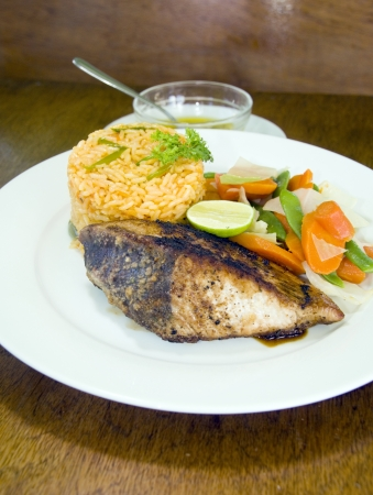 fresh Caribbean style yellowfin tuna steak with vegetables rice as photographed in Union Island St. Vincent and the Grenadines