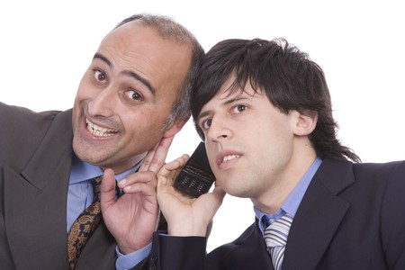 Two successful businesspeople trying to listen something at a cellphone