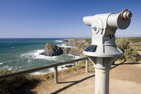 Coin operated telescope in a cosatline viewpoint overlooking the ocean (Pay per view concept)