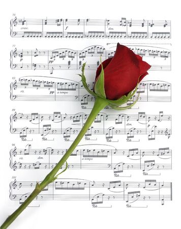 Single red rose over sheet music