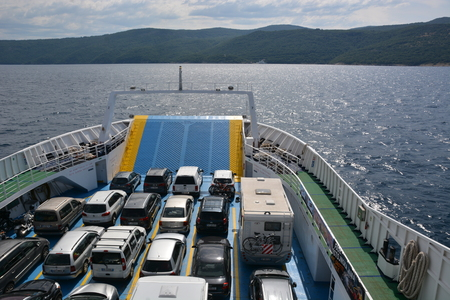Cres, Croatia - June 16, 2017 - Car ferry on its way to island Cres