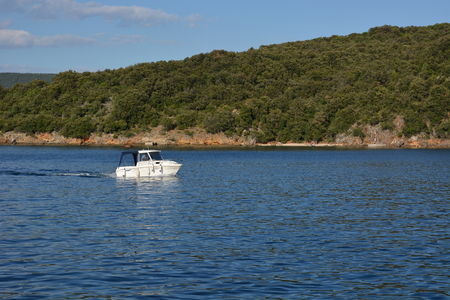 Cres, Croatia - June 18, 2017 - Motorboat near Valun on island Cres