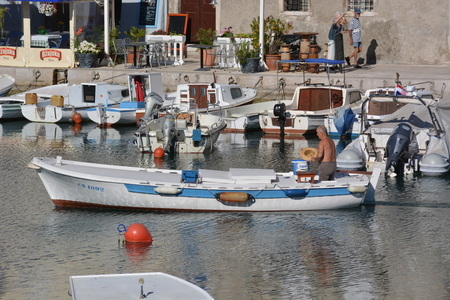 Cres, Croatia - June 18, 2017 - City of cres with boats and fishing boat