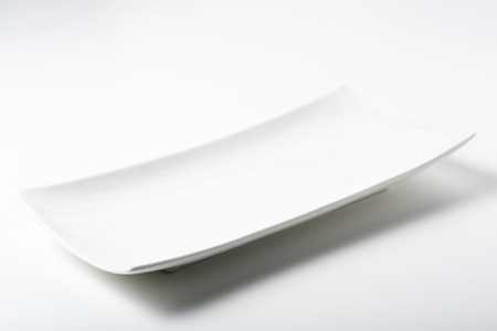 Photo for a white rectangular plate with rounded corners - Royalty Free Image
