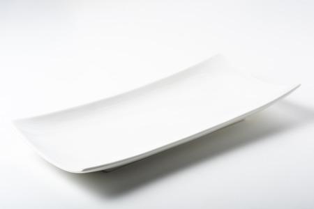 Foto de a white rectangular plate with rounded corners - Imagen libre de derechos