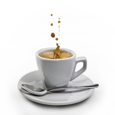 Splashing coffee on isolated coffee cup