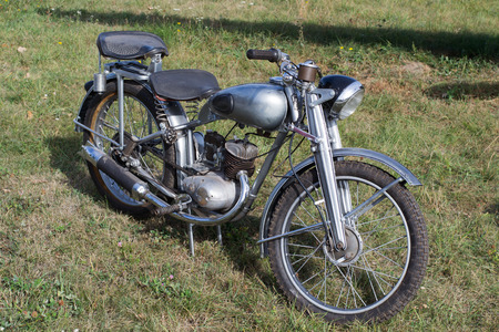 Russian old retro bike in black standing on the grass