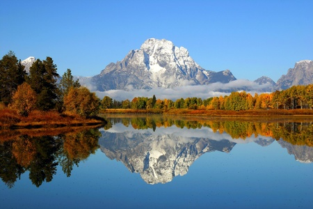 Reflection of mountain range in a lake at Grand Teton National Park