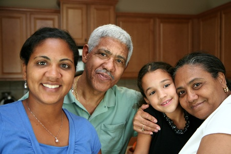 Minority family standing in their kitchen