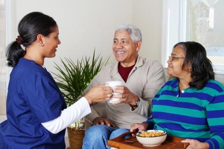 Photo pour Home health care worker and an elderly couple - image libre de droit