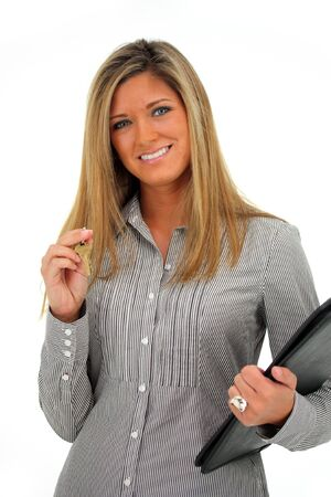 Woman Holding a Set of Keys with a White Background