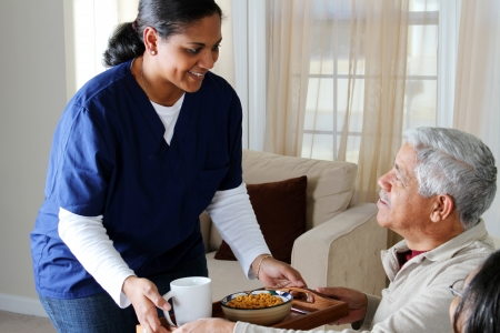 Photo for Home health care worker and an elderly couple - Royalty Free Image