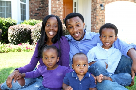 African American family together outside their home