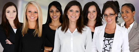 Photo pour Businesswomen of all races working together in an office - image libre de droit