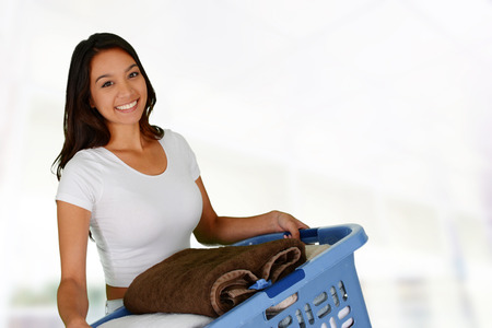 Woman who is doing laundry in her home