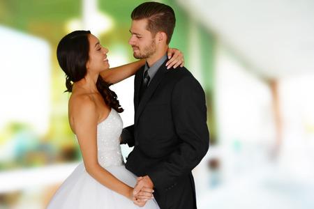 Foto de Woman in a beautiful white wedding dress with groom - Imagen libre de derechos