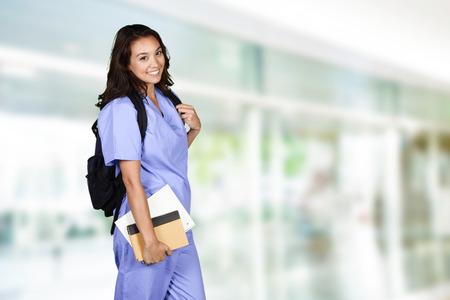 Photo pour Female nurse who is studying for her job - image libre de droit
