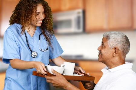 Foto de Health care worker helping an elderly man - Imagen libre de derechos