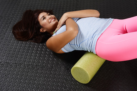 Woman using a foam roller after a workout