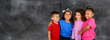 Photo for Group of happy young children who are at school - Royalty Free Image