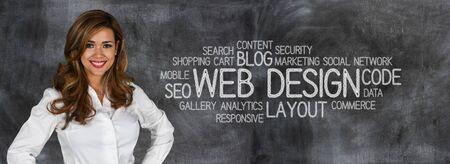 Photo pour Woman who is designing a web site - image libre de droit