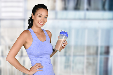 Woman enjoying a protein shake after her workout