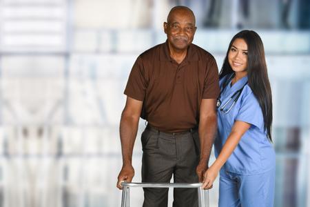 Photo pour Health care worker helping an elderly patient - image libre de droit