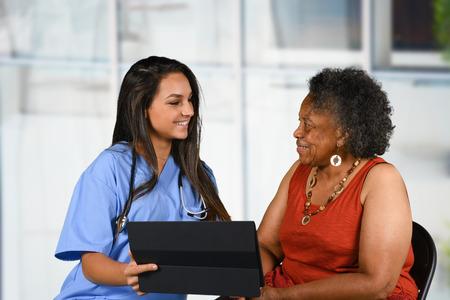 Photo pour Health care worker helping an elderly woman - image libre de droit