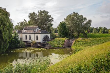 Photo pour The paddle wheel pumping station was commissioned in 1859 to remove the water from the polder. Originally it was powered by steam and later electrically. Since 1962 it is no longer in use as such. - image libre de droit