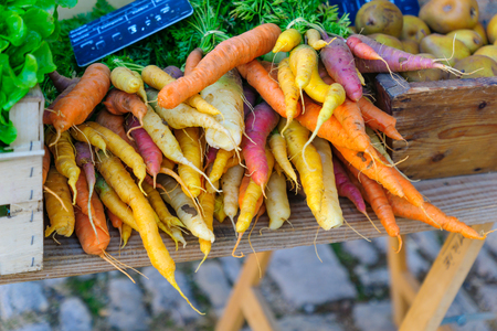 Various carrots on sale in a French market, in Noyers-sur-Serein, Burgundy, France