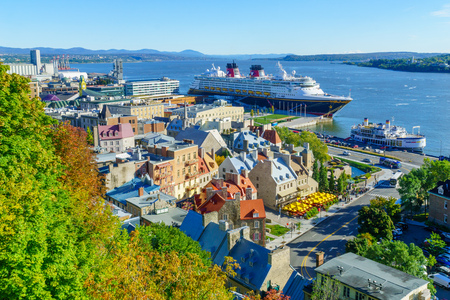 Quebec City, Canada - September 27, 2018: View of lower town and the Saint Lawrence River, with locals and visitors, in Quebec City, Quebec, Canada