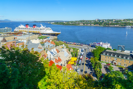 Quebec City, Canada - September 27, 2018: View of the lower town and ferry traffic in the Saint Lawrence River, with locals and visitors, Quebec City, Quebec, Canada