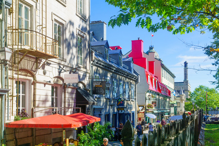 Quebec City, Canada - September 27, 2018: Scene of the old town, with historic buildings, locals and visitors, in Quebec City, Quebec, Canada