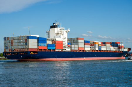 Photo pour Container ship in the port of Rotterdam, Holland - image libre de droit