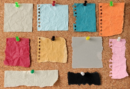 set colorful stickers note pinned to a cork board