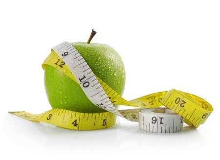 fresh apple with measuring tape. diet concept, loss weight