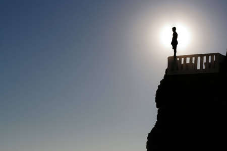 A man pepares to jump off a cliff in Mazatlan, Mexico.