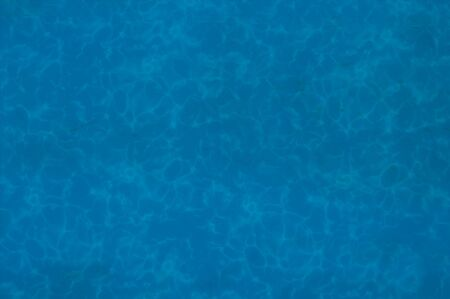 The bottom of a pool of dep blue water.