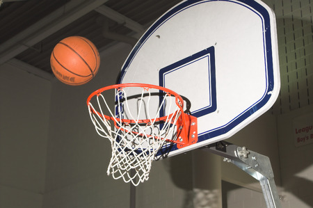 A basketball being shot into a goal.