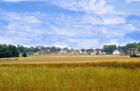 A new housing develpoment encroaching on farmland.