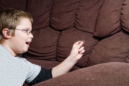 A person Finding Money in couch cushions.