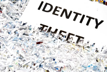 Identity Theft typed on a shredded piece of paper.