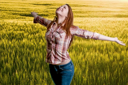 A woman free of allergies standing in a field