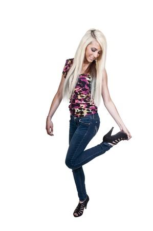 A beautiful young woman rubbing her sore tired feet