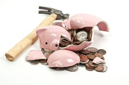 Broken piggy bank filled with loose change