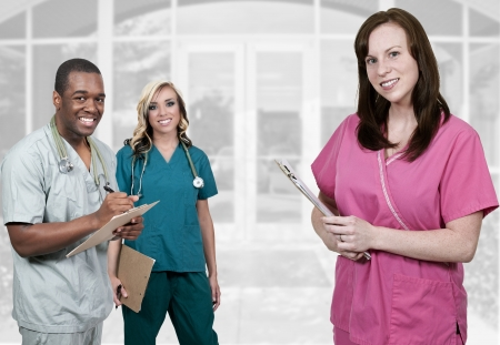 Photo pour Medical professionals standing in front of an office or hospital - image libre de droit