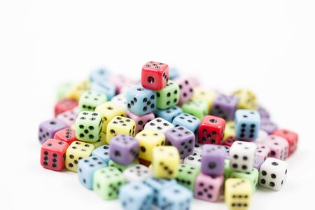 lucky dice of different colors with blur background