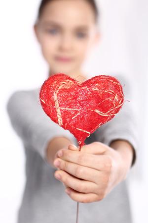 Photo pour Portrait of a baby with a heart Valentine - image libre de droit