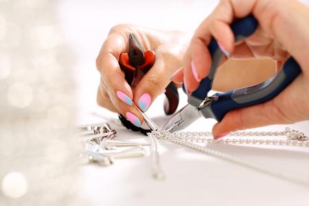 Photo pour Workshop jewelery. Female hand performs jewelery - image libre de droit